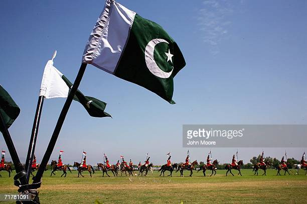 Pakistani flags wave in the breeze as a presidential guard rides by at a parade ground on September 4 2006 Rawalpindi Pakistan Army soldiers are...