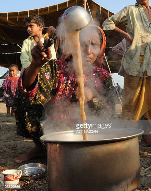 A Pakistani flood survivor prepares breakfast at a roadside in the outskirts of Sukkur on August 10 2010 The United Nations is launching an appeal to...