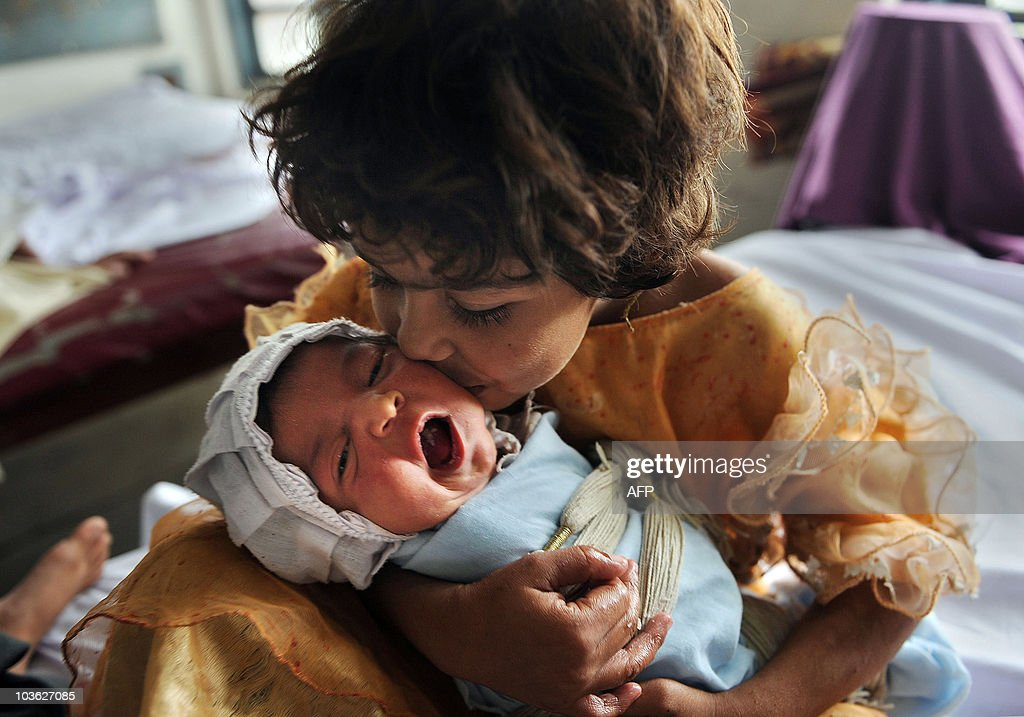 A Pakistani Flood Affected Girl Kisses A