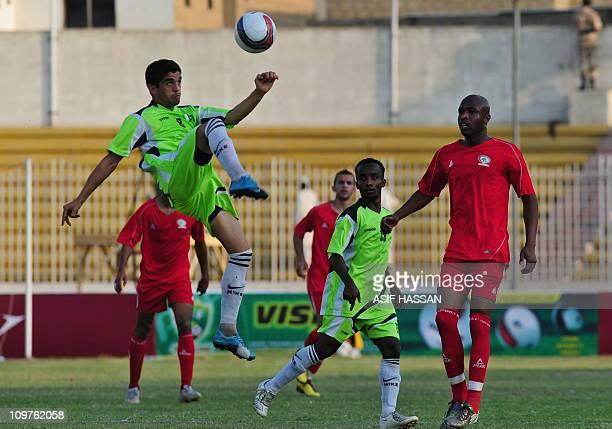 Pakistani football team player Mehmood Khan kicks the ball during an International friendly against Palestine in Karachi on March 4 2011 AFP PHOTO/...