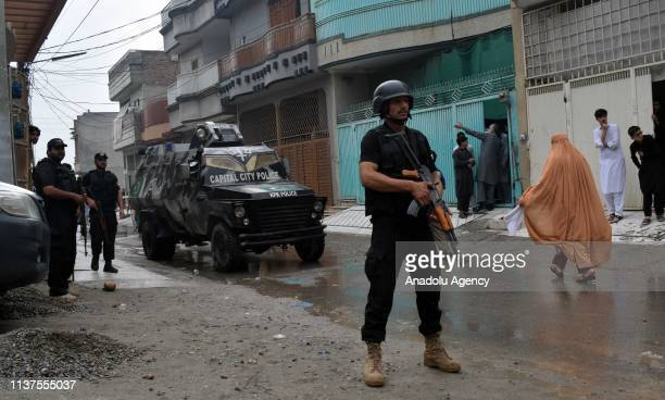 Pakistani forces are seen near a building being used by militants as hideout during an operation against them in the Pakistani northern city of...