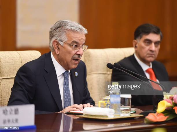 Pakistani Foreign Minister Khawaja Muhammad Asif attends a meeting with Chinese State Councilor and Foreign Minister Wang Yi at the Diaoyutai State...