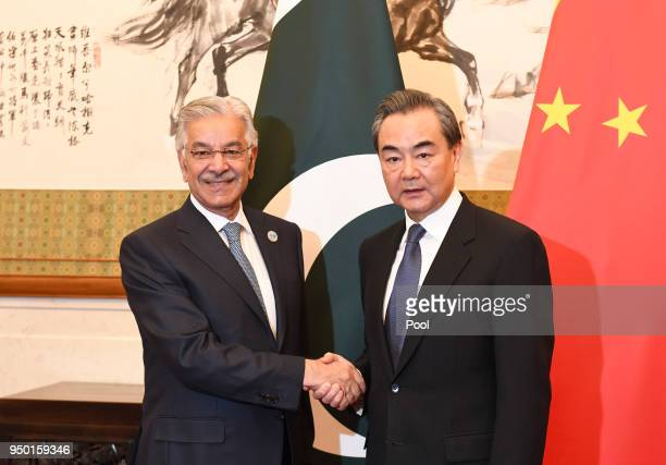 Pakistani Foreign Minister Khawaja Muhammad Asif shakes hands with Chinese State Councilor and Foreign Minister Wang Yi prior to talks at the...