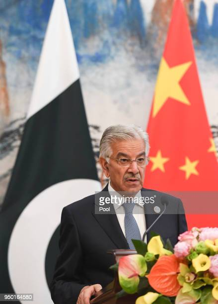 Pakistani Foreign Minister Khawaja Muhammad Asif speaks at a joint news conference with Chinese State Councilor and Foreign Minister Wang Yi at the...