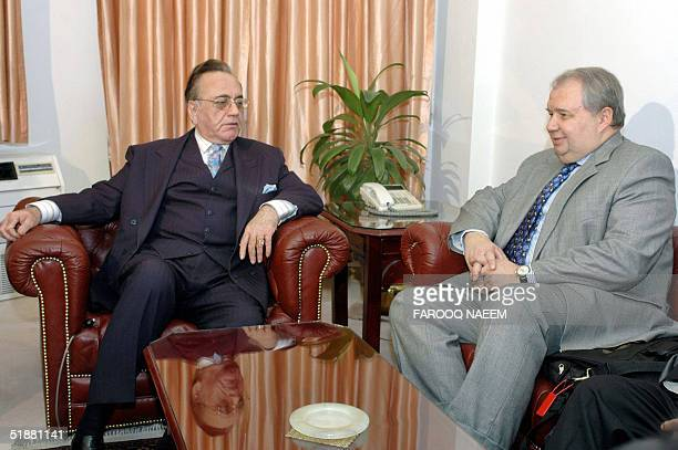 Pakistani Foreign Minister Khurshid Kasuri listens to Russian Deputy Foreign Minister Sergey Kislyak during a meeting in Islamabad 20 December 2004...
