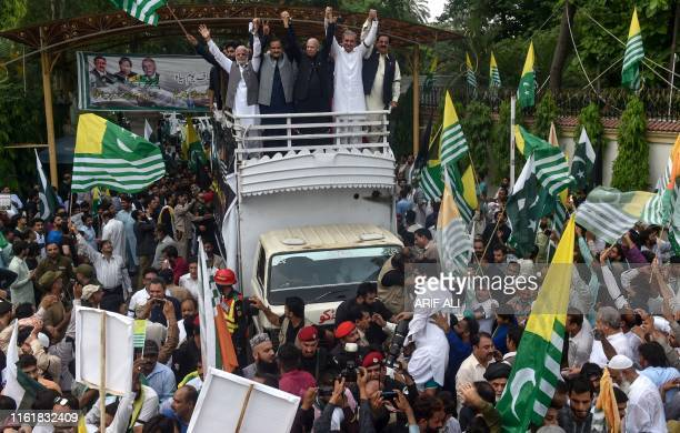 Pakistani Foreign Minister Shah Mehmood Qureshi and other party leaders take part in a protest rally against India in Lahore on August 15 as the...