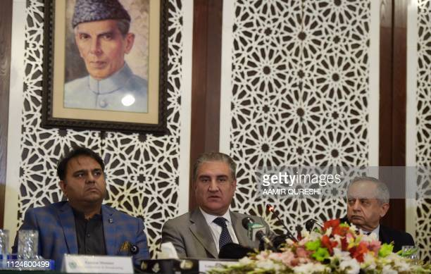 Pakistani Foreign Minister Shah Mehmood Qureshi speaks next to Pakistan's advisor for Commerce Textile Industry and Production and Investment Abdul...