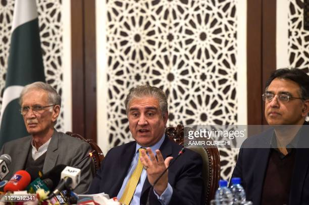 Pakistani Foreign Minister Shah Mehmood Qureshi speaks next to Defence Minister Pervez Khattak and Finance Minister Asad Umar during a press...