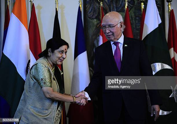 Pakistani Foreign Minister's adviser Sartaj Aziz shake hands with Indian Foreign Minister Sushma Swaraj after the 5th Heart of AsiaIstanbul Process...