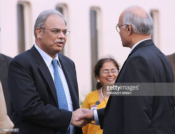 Pakistani Foreign Secretary Riaz Mohammad Khan shakes hands with Indian Foreign Secretary Shiv Shankar Menon upon his arrival at the international...