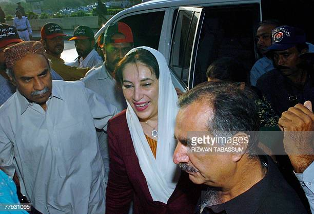 Pakistani former premier Benazir Bhutto arrives at the Jinnah International airport in Karachi 27 October 2007 Bhutto was traveling to her ancestral...