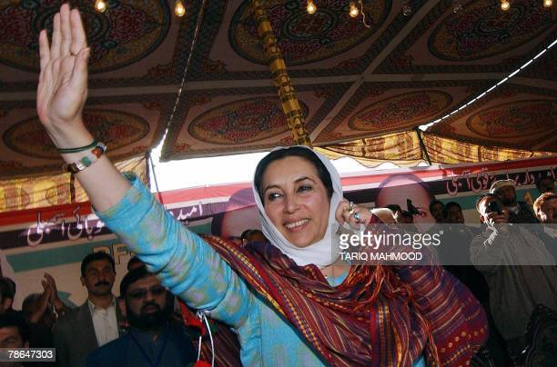 Pakistani former prime minister Benazir Bhutto waves to her supporters during an election public meeting in Peshawar 26 December 2007 Opposition...