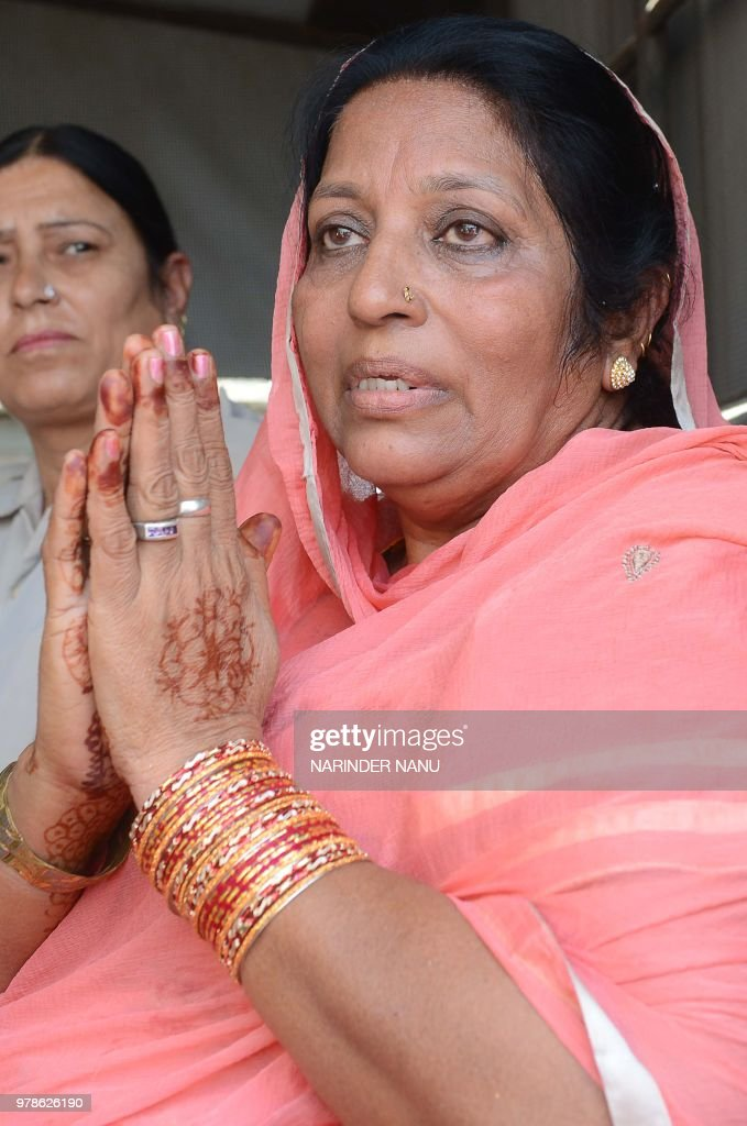 Pakistani former prisoner Nasreen Akhtar gestures as she was released from Amritsar Central Jail on the outskirts of Amritsar on June 19 2018 India...