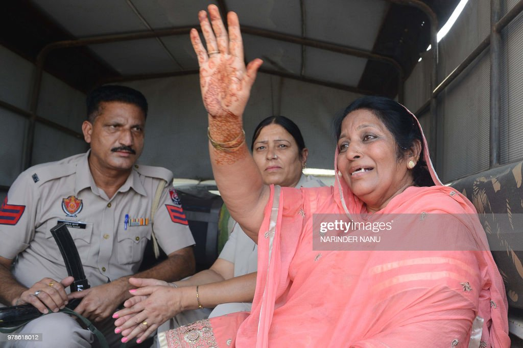 Pakistani former prisoner Nasreen Akhtar waves as she was released from Amritsar Central Jail on the outskirts of Amritsar on June 19 2018 India...