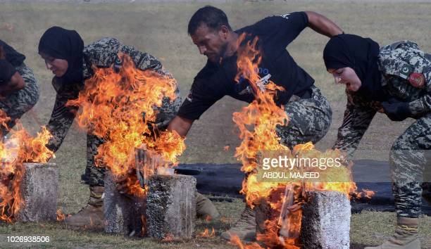 Pakistani Frontier Constable personnel take part in a drill ahead of Pakistan's Defence Day in Peshawar on September 5 2018 Pakistan celebrate...