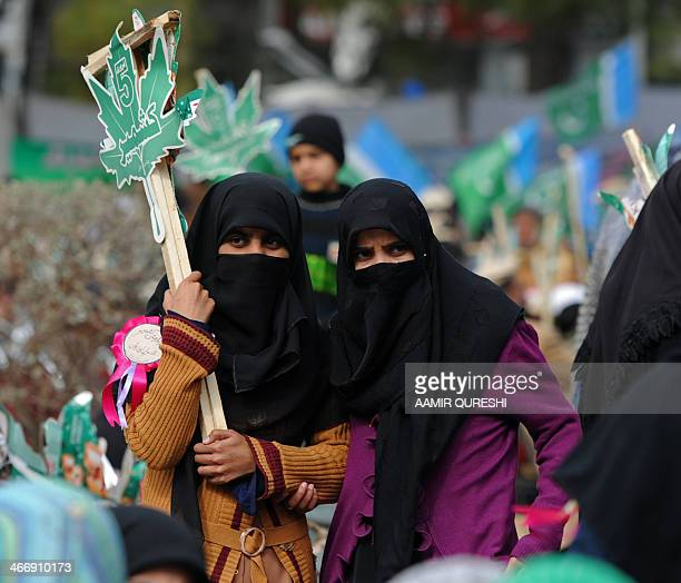 Pakistani fundamentalist Islamic political party JamaatiIslami activists listen to a speech by their party leader Munawar Hassan during the Kashmir...