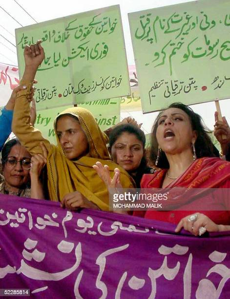 Pakistani gang rape victim Mukhtiar Mai shout slogans as she takes part with NGO members in a demonstration in Multan 07 March 2005 Mai led an...