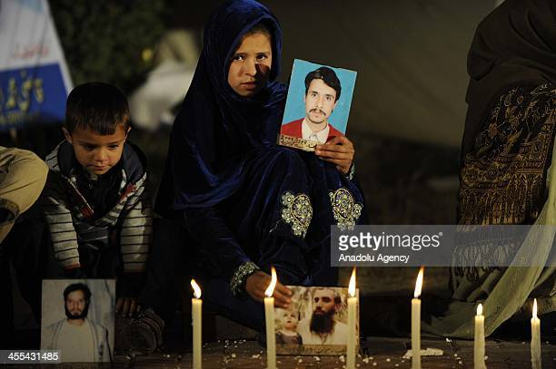 Pakistani girl holds a picture of her relative during a sitin protest in a camp set up by families of missing people at D Square outside the...