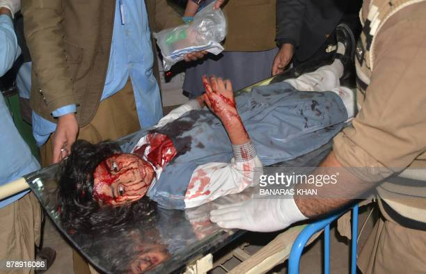 A Pakistani girl injured in a suicide bombing arrives for treatment at a hospital in Quetta on November 25 2017 At least four people died and 19...