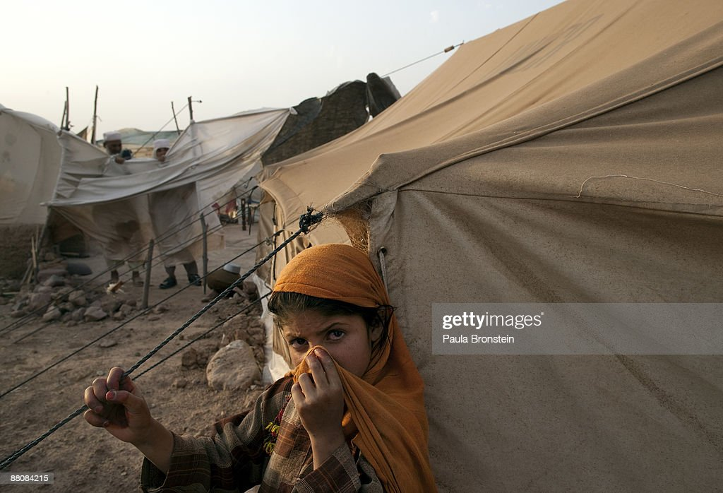 A Pakistani girl stands outside her tent as the wind and dust blows making conditions in & Fighting Forces Displaced Pakistan Civilians Into Camps Photos and ...