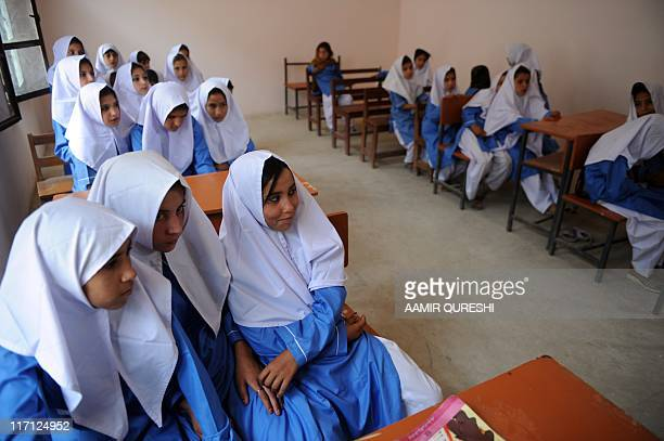 Pakistani girls attend a class at a school in the mountainous area of the Jhanda tribal district of Mohmand Hills on June 1 2011 during a media trip...