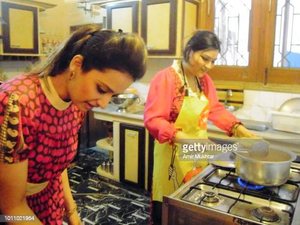 Pakistani girls cooking food in the kitchen