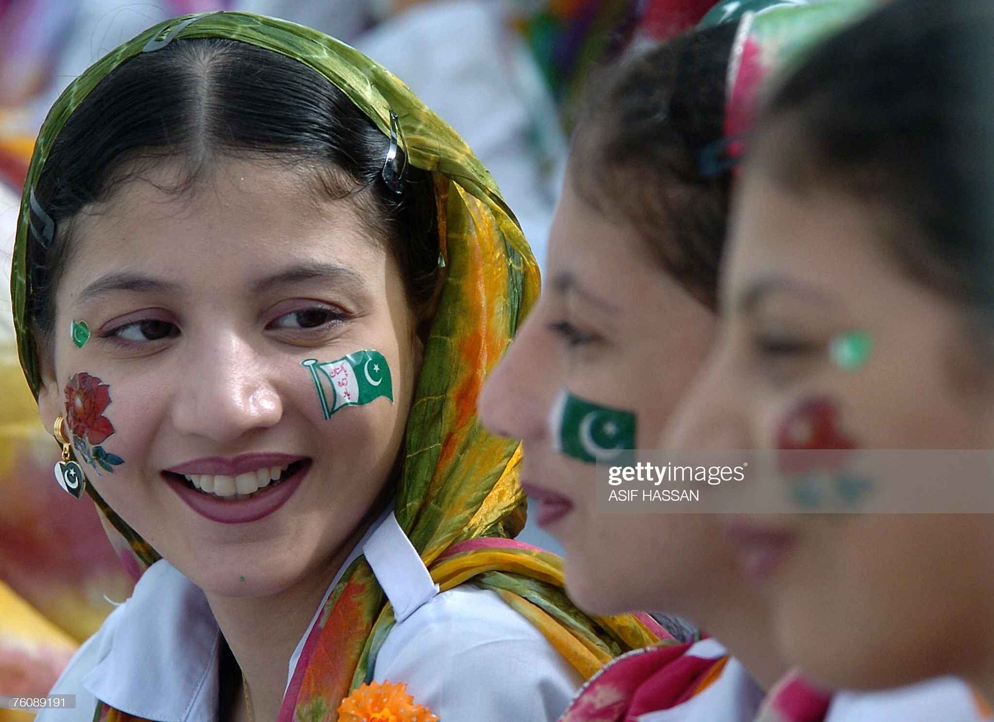 Pakistani girls, their faces painted in : News Photo