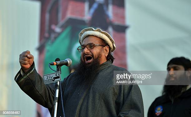 Pakistani head of the banned organisation JamaatudDawa and alleged mastermind of the 2008 Mumbai attacks Hafiz Saeed addresses a gathering during a...