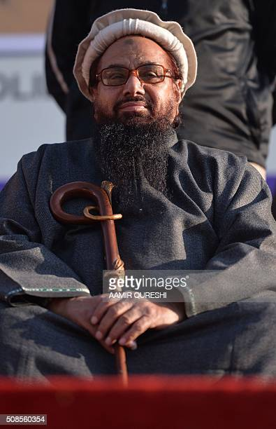 Pakistani head of the banned organisation JamaatudDawa and alleged mastermind of the 2008 Mumbai attacks Hafiz Saeed attends meeting during a protest...