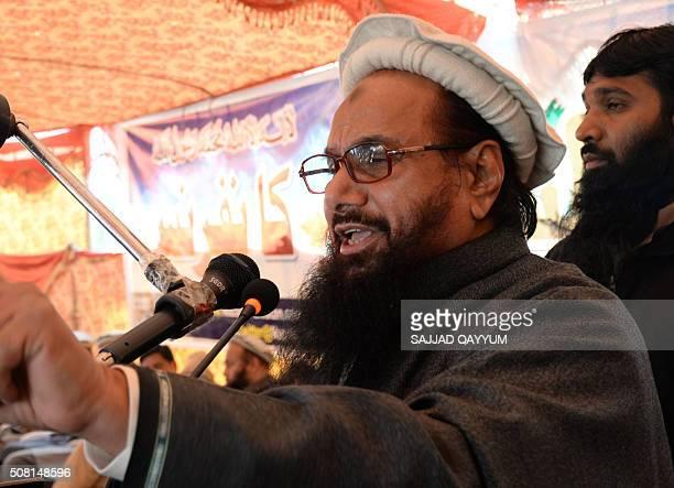 Pakistani head of the banned organisation JamaatudDawa Hafiz Saeed addresses a gathering during a protest rally in Muzaffarabad the capital of...