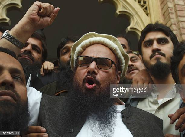 Pakistani head of the JamaatudDawa organisation Hafiz Saeed speaks to the media after his release order outside a court in Lahore on November 22 2017...