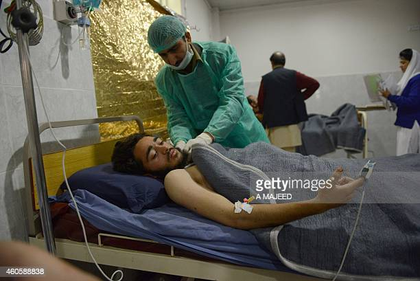 Pakistani health workers treat a student at a hospital a day after an attack by Taliban militants at an armyrun school in Peshawar on December 17...