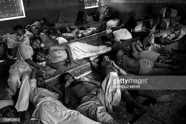 Pakistani heroin addicts rest at The Edhi rehabilitation centre in Karachi on July 25 2011 The Edhi Home is home to people addicted to drugs...