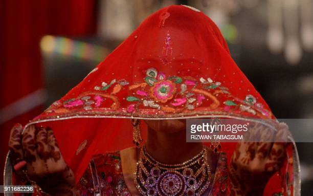 A Pakistani Hindu bride attends a mass wedding ceremony in Karachi on January 28 2018 The 10th Annual Hindu Combined Marriages Ceremony with 83...