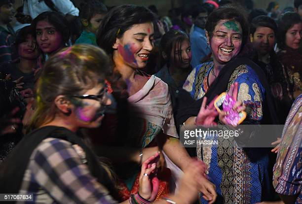 Pakistani Hindu girls take part in celebrations for the Holi festival in Karachi on March 23 2016 The Hindu festival of Holi celebrates the welcoming...