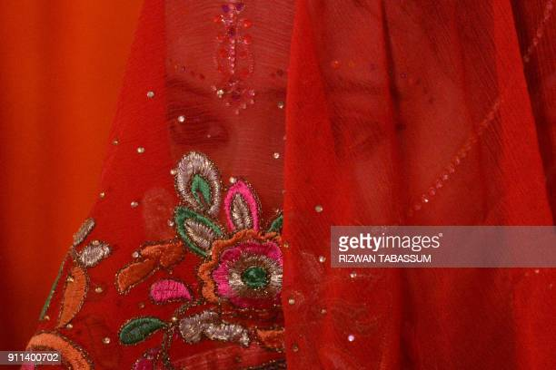 Pakistani Hindu groom poses at a mass wedding ceremony in Karachi on January 28, 2018. The 10th Annual Hindu Combined Marriages Ceremony with 83...
