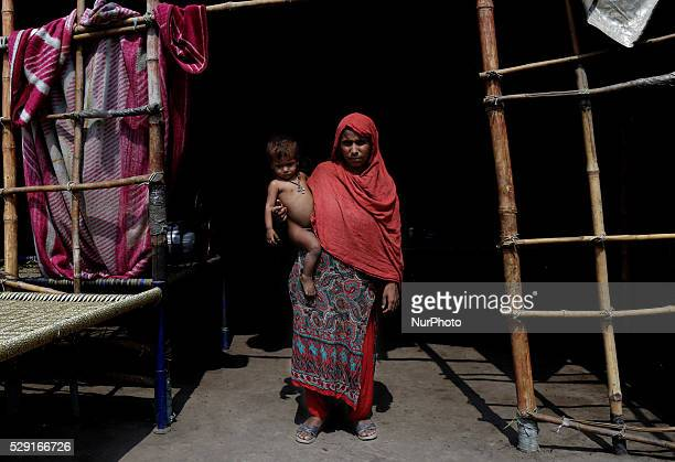 A pakistani homeless woman shamim stand with own child outside of tiny makeshift house in slum of LahoreMay 6Pakistan Mostly homeless people come...