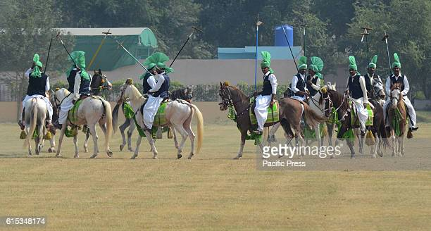 Pakistani horse rider player in action during National Tent Pegging championship 2016 held at Headquarters Pakistan Rangers in Lahore Tent pegging is...