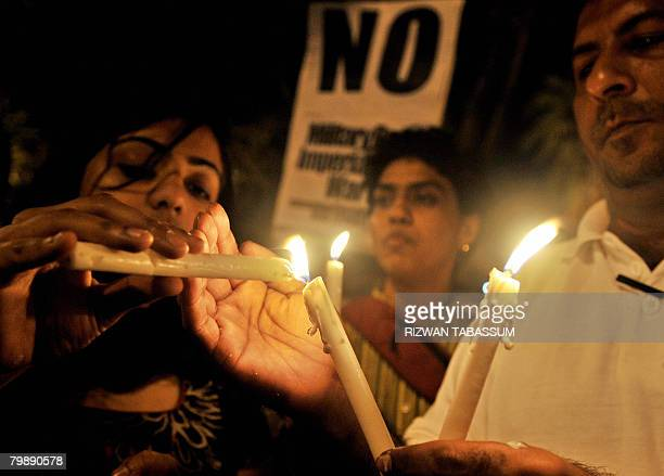 Pakistani human rights activists hold a candlelight vigil during an antiPresident Pervez Musharraf demonstration in Karachi on February 21 2008...