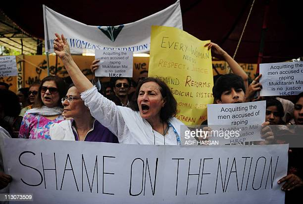 Pakistani human rights activists hold placards in the support of rape victim Mukhtar Mai during a demonstration in Karachi on April 23 2011 Human...