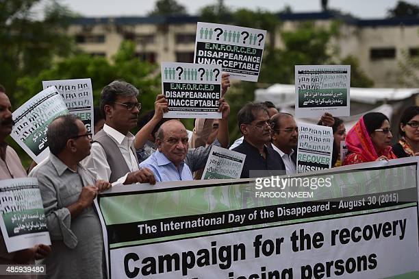Pakistani human rights activists protest in support of missing persons on the International Day of the Victims of Enforced Disappearances in...