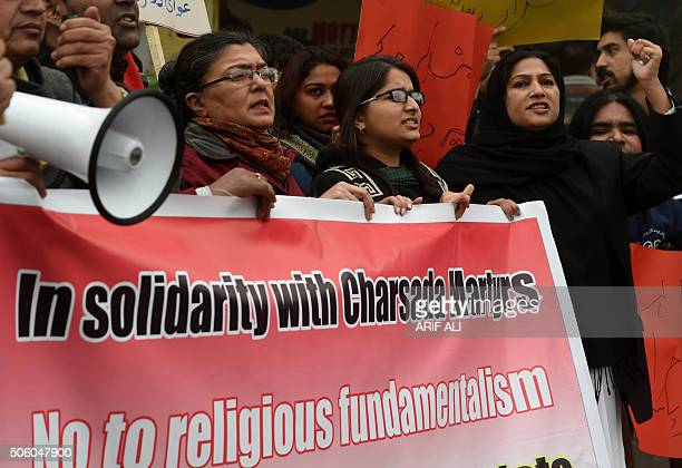 Pakistani human rights activists shout slogans against a militant attack on a university during a demonstration in Lahore on January 21, 2016....