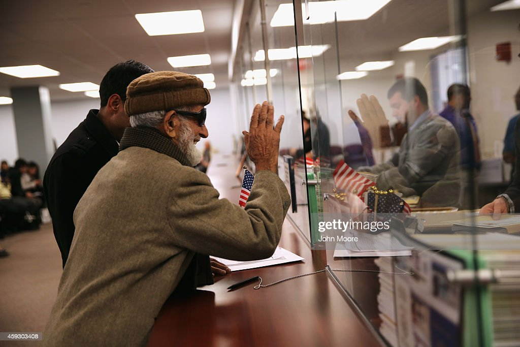 Pakistani immigrant Amanat Ali, 82, thanks an immigration officer after receiving his U.S. citizenship certificate at the United States on November 20, 2014 in Newark, New Jersey. He became an American citizen at a natualization ceremony in the office of the U.S. Immigration and Citizenship Services (USCIS), at Newark's Federal Building.