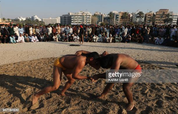 Pakistani immigrant workers in the United Arab Emirates take part in a Kushti competition in Dubai on March 16 2018 Kushti is popular in India...
