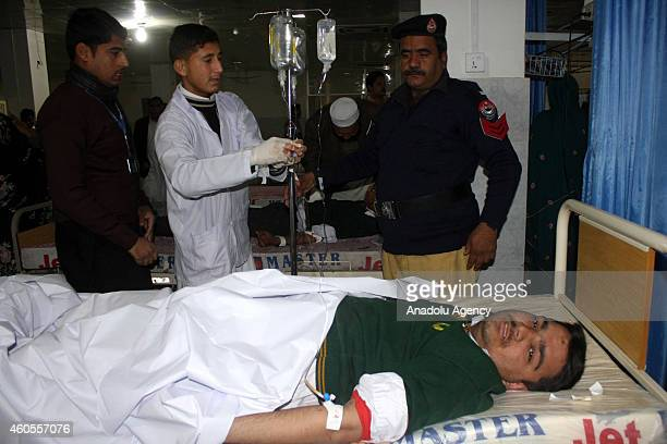 Pakistani injured man is treated at the hospital after Taliban assault on an armyrun school in the northwestern city of Peshawar Pakistan on December...