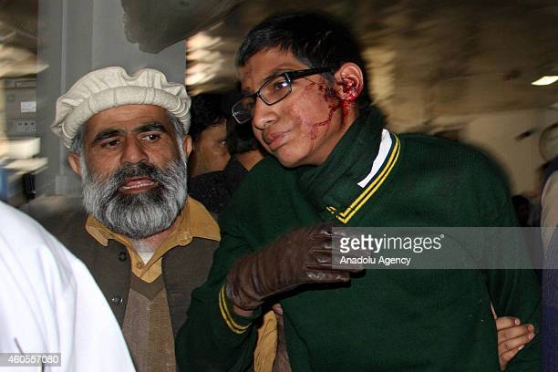 Pakistani injured student is treated at the hospital after Taliban assault on an armyrun school in the northwestern city of Peshawar Pakistan on...