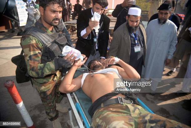 Pakistani injured victim is being carried on a stretcher at a hospital following an attack on Peshawar Agricultural Training Institute by Taliban...