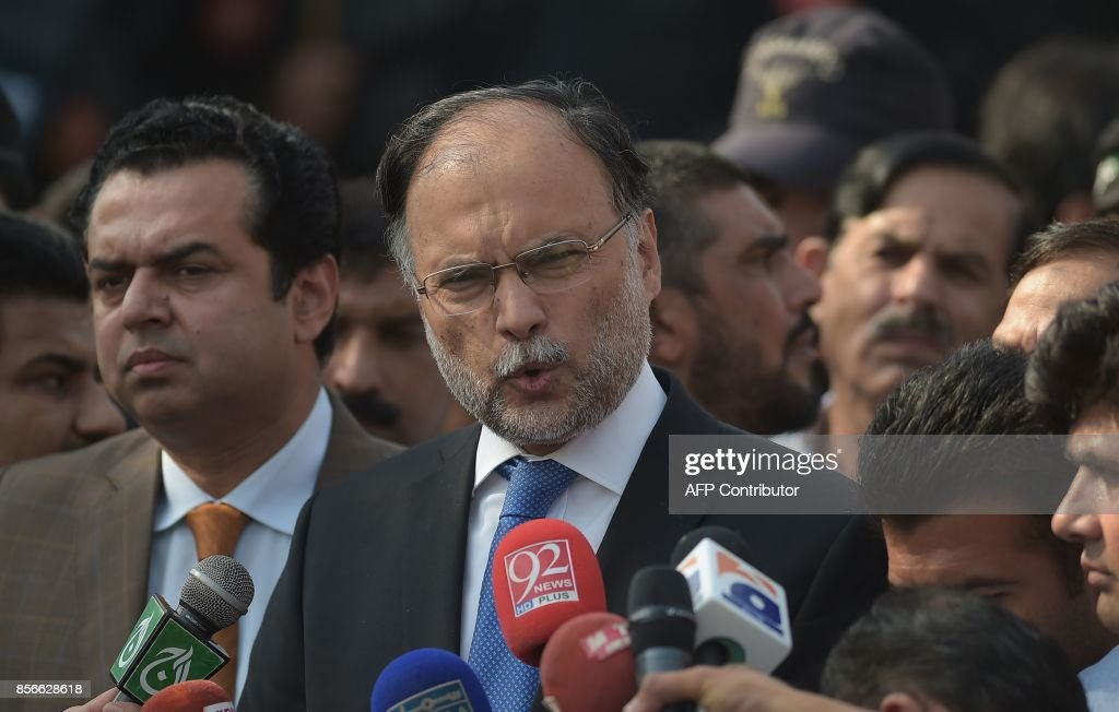 Pakistani Interior Minister Ahsan Iqbal (C) speaks to media outside an accountability court where sacked prime minister Nawaz Sharif appeared to face corruption charges in Islamabad on October 2, 2017. Sacked Pakistani Prime Minister Nawaz Sharif made a second appearance before an anti-corruption court on October 2, as officials said he would be indicted at a later hearing on corruption charges that could ultimately see him jailed. /