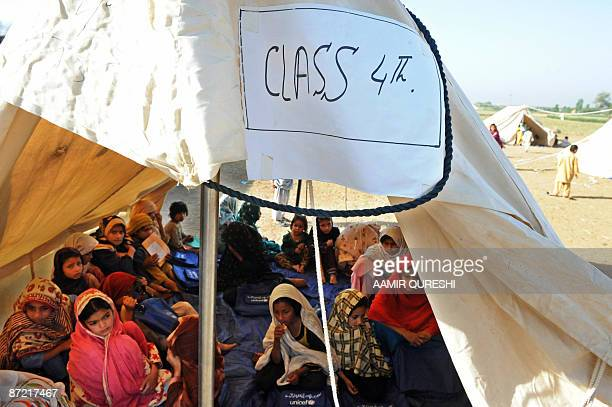 Pakistani internally displaced children fleeing from military operations against Taliban militants in troubled Swat valley and Buner attend a class...