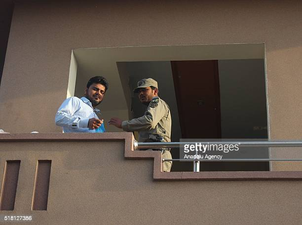 Pakistani investigators collect evidence from a house where five terrorists killed during a police raid in late night outskirts of Lahore in Pakistan...